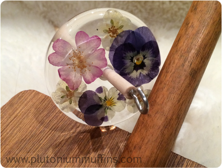 Close-up of the spindle, with pressed flowers from Louise's garden.