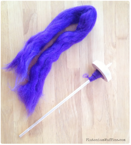 Spinning purple roving and mini spindle.