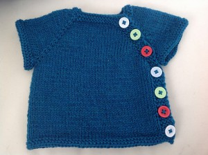 Tabby15 finished this lovely baby cardigan.