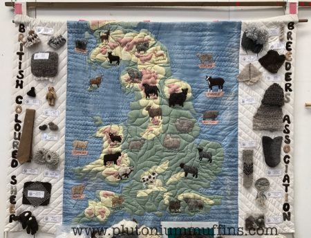 A quilted map of the UK showing all the coloured sheep in their locations.