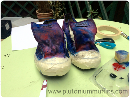 The masked shoes with an underlayer of paint, drying and ready to have stars put on them.