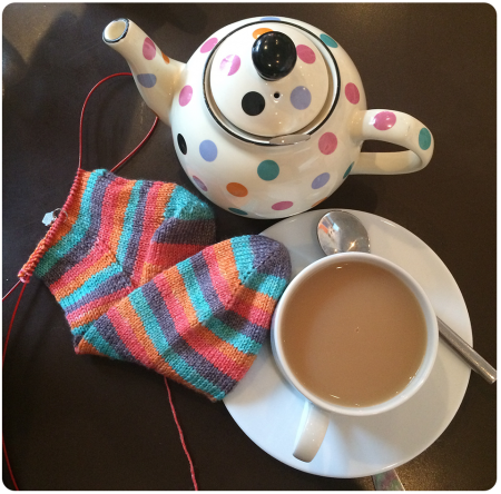 Working on my Angel socks with a matching teapot in Edinburgh!