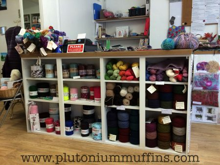 The yarns on the right of the till are handspun and speciality yarns from the Natural Fibre Company.