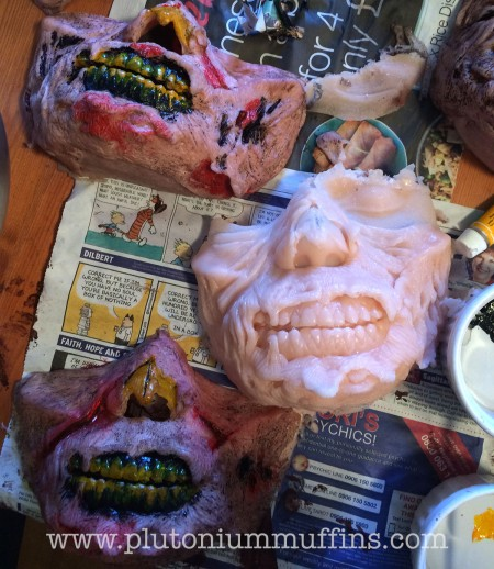 An unpainted zombie mask in the middle, with two painted top and bottom. Zombie invasion of the farm: ready!