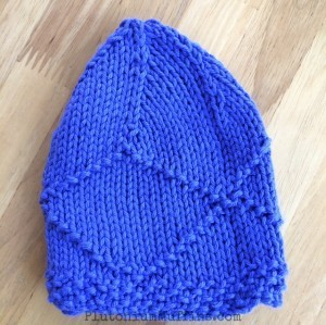 This is more similar to the shape I would expect a baby hat to be...still not right though, so folded in half it doesn't work either. Sigh.