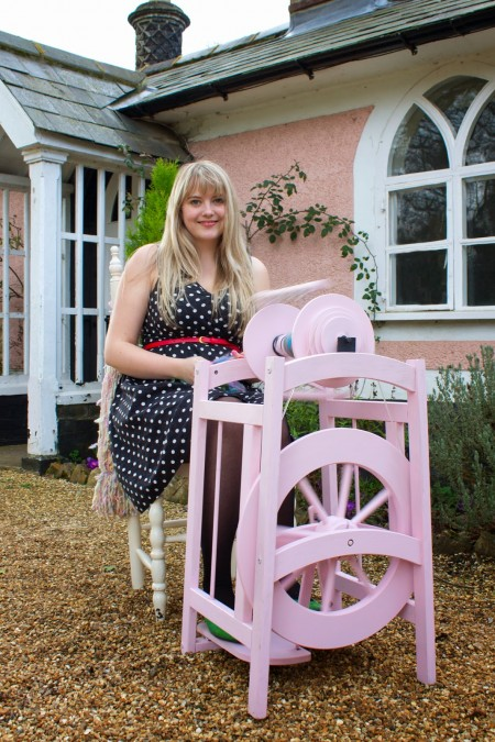 A gorgeous pink spinning wheel, with a smiling Louise in her throne.